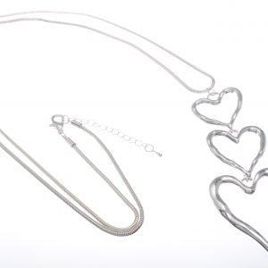 Cascading triple heart pendant