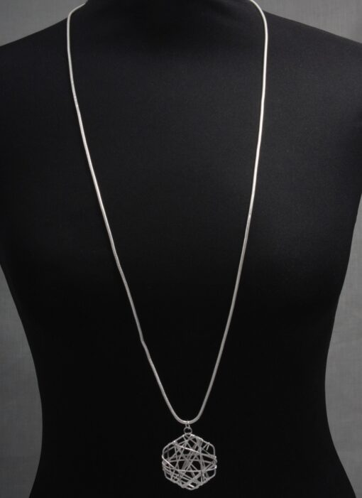 Abstract circle pendant on long necklace